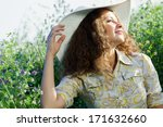 young beautiful girl in hat and ... | Shutterstock . vector #171632660