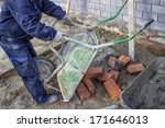 worker unload a wheelbarrow... | Shutterstock . vector #171646013