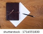 old leather notepad with blank... | Shutterstock . vector #1716551830