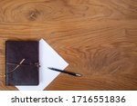 leather notepad and notepad on... | Shutterstock . vector #1716551836
