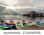The staff prepared many kayaks for tourists in the morning atmosphere. Surrounded by mountains,Ratchaprapa dam and Cheow larn dam, khao sok,Surat thani - stock photo