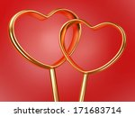 two golden hearts shape on red background - stock photo