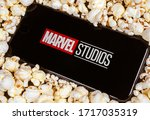 Small photo of Dallas, TX/USA April 2020: Marvel studios logo on smartphone screen. Marvel studios produces movies centered around marvel comic book superheroes.
