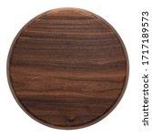 Small photo of Handmade black walnut round wooden chopping board. Walnut round wooden pallet. Black walnut wood plank texture background.