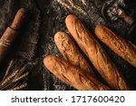 freshly bread baguettes on... | Shutterstock . vector #1717600420