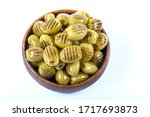 Small photo of barbecued grilled green olive indispensable flavor of breakfast. Grilled green olives on white background.