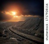 Small photo of Sunset over the spoil tip, slag heap, terril, terrikon, coal mine, Donbass landscape, road on the spoil tip, Eastern Ukraine landscape, symbol of Donbass, fantastic landscape. Террикон. Mystery world