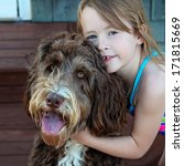 Stock photo little girl with pet dog closeup 171815669
