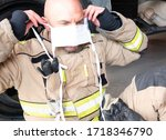 Firefighter Wears A Mask To...