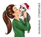Girl Holding Cat In Christmas...