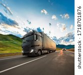 Small photo of Truck with container on highway, cargo transportation concept. Shaving effect.