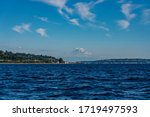 Mount Ranier appears to float above Elliot Bay and the hills near Seattle, Washington on a sunny summer afternoon. - stock photo