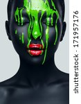 Woman With Flowing Green Paint...