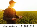 Young Man Farmer Stands In A...