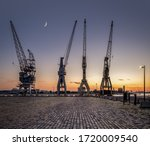 A Row Of 4 Old Harbor Cranes In ...