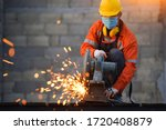 Industrial Worker Cutting And...