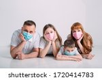 Young Family In Medical Masks...