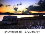 camper near lake in stunning... | Shutterstock . vector #172050794