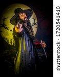 beautiful boy gothic demon vampire hunter with stake - stock photo