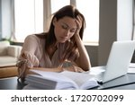 Small photo of Tired sleepy woman sitting at desk with laptop, holding head, resting on hand, sleeping at workplace, bored young female feeling drowsy, lazy and unmotivated student, boring job, lack of sleep