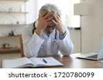 Tired Depressed Old Male Doctor ...