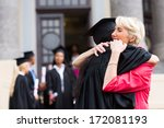young female graduate hugging... | Shutterstock . vector #172081193