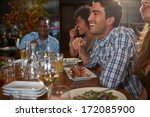 group of friends enjoying meal... | Shutterstock . vector #172085900