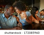 couple enjoying drink at bar... | Shutterstock . vector #172085960
