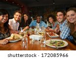 group of friends enjoying meal... | Shutterstock . vector #172085966