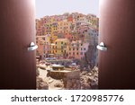 Small photo of Sale of tour packages. The end of the quarantine of the coronavirus pandemic, the opening of the borders of countries. Doors swing open overlooking the village of Manarola in the Cinque Terre, Italy