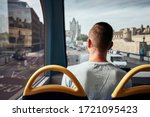 Man Traveling By Double Decker...