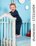 baby playing on bed   Shutterstock . vector #172116404