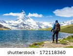 tourist with a backpack and... | Shutterstock . vector #172118360