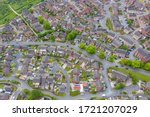 Aerial photo of a typical British housing estate in the village of Middleton in Leeds West Yorkshire in the UK, showing a top down drone view of suburban streets, roads and rows of houses.