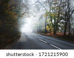 An Empty Asphalt Road Through...
