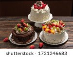 Various Cakes On Wooden...