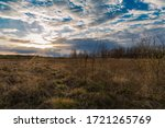 Clouding Sunset In A Field In ...