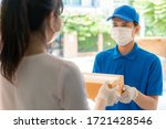 Asian Delivery Man Wearing Face ...