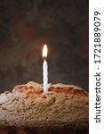 Small photo of Congratulations on your birthday one years. Happy birthday 1. Holiday candle one on a bright background. one years old. one years old child. Burning candle. Greeting card with a one-year anniversary