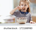 girl eating flakes at the... | Shutterstock . vector #172188980