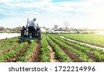 A Farmer On A Tractor...