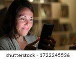 Adult Woman Using Smartphone...