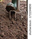 Gardener Digging The Earth Ove...
