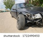 Small photo of The body of the car is damaged as a result of an accident. High speed head on a car traffic accident. Dents on the car body after a collision on the highway
