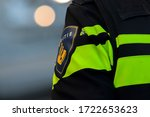 Small photo of Close Up Of A Logo Of A Policeman At Amsterdam The Netherlands 2020