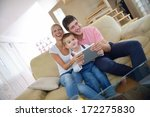 happy young family using tablet ... | Shutterstock . vector #172275830