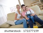 happy young family using tablet ... | Shutterstock . vector #172277159