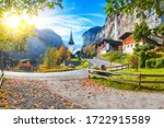 Stunning autumn view of Lauterbrunnen village with awesome waterfall  Staubbach  and Swiss Alps in the background.  Location: Lauterbrunnen village, Berner Oberland, Switzerland, Europe. - stock photo