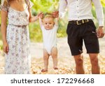 happy young family holding a...   Shutterstock . vector #172296668