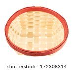 Empty wicker basket with the red edge, isolated over white background - stock photo